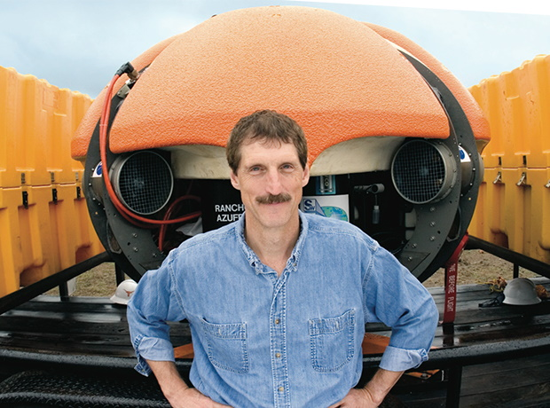 Photo of Bill Stone in front of DEPTHX vehicle from IEEE news coverage